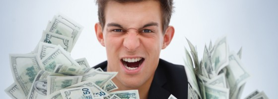 closeup of a young business man holding money 560x201