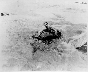 Houdini swims river in scene from The man from beyond 300x246