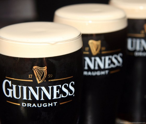 three full guinness draught glasses 560x477