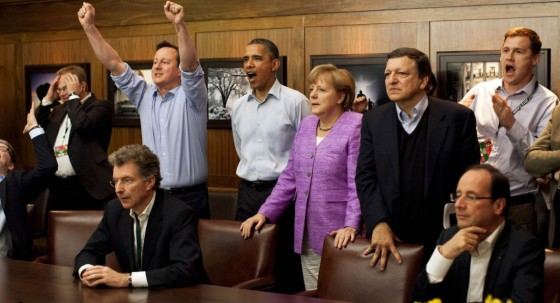 Obama Merkel watching Chelsea 560x303