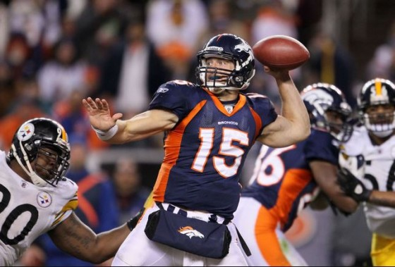 Tim Tebow Throwing Football 560x379