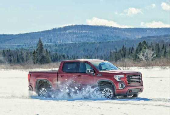2019 GMC Sierra AT4 Red Driving on Lake Elmore Vermont 1 560x380