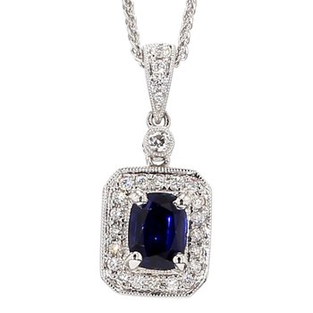 1.55 Natural Blue Sapphire Accented With .25 Carat Diamond Halo And Bezel Crafted in 14 Karat White Gold With A 18 Inch 14 Karat White Gold Wheat Chain
