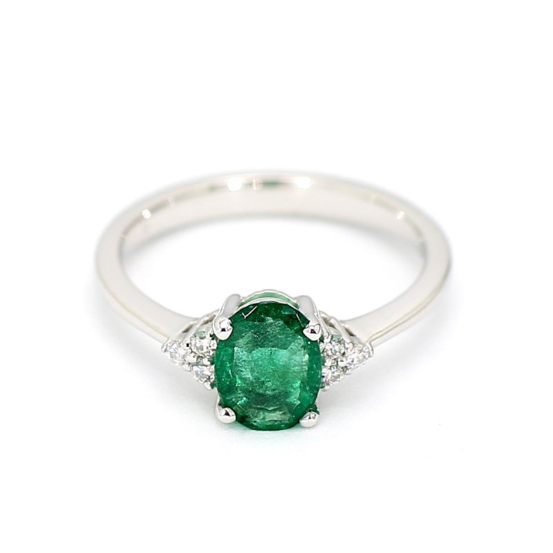 .99 Carat Oval Green Emerald And .09 Carat Diamonds Fashion Ring Crafted In 14 Karat White Gold