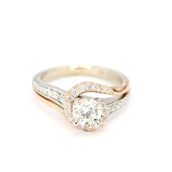 1.06 Carat Diamond 14 Karat Rose And Gold Infinity By-pass Engagement Ring.