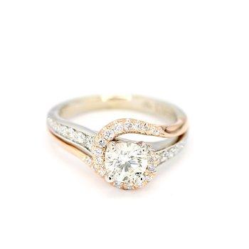 1.06 Carat Diamond 14 Karat Rose And Gold Infinity By-pass Engagement Ring.