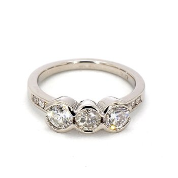 Three stone bezel set ring