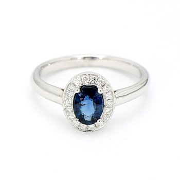 .72 Carat Blue Sapphire And .11 Carat Diamond Halo Ring