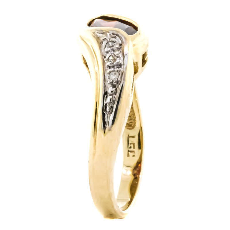 Estate Jewelry 10K Gold Garnet and Diamond Bypass Style Ring