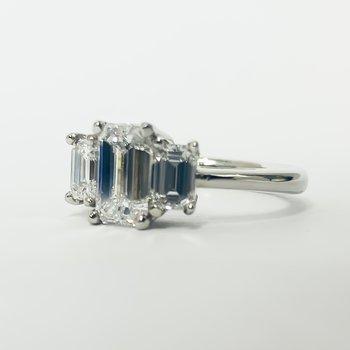 Platinum Three Stone Emerald Diamond Ring
