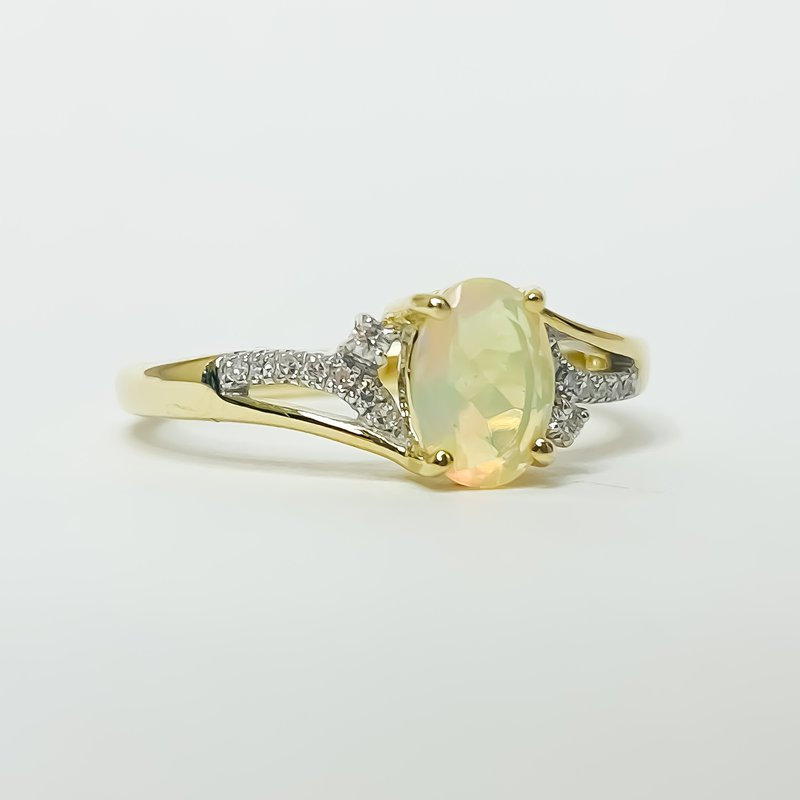Iroff and Son Jewelers  10K Gold Opal and diamond Bypass Split Shank ring