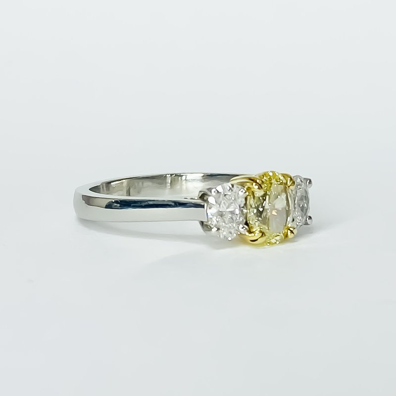 Iroff and Son Jewelers  Platinum GIA Yellow Oval Three Stone Engagement Ring