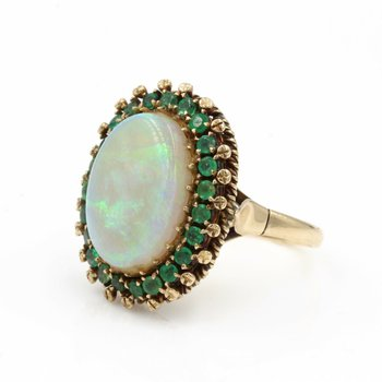 14K YELLOW GOLD RING WITH AN OPAL CABOCHON  SURROUNDED BY ROUND EMERALDS E-30