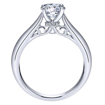 Solitaire Engagement Ring Setting featuring 12 round cut Diamonds in 18K white gold.