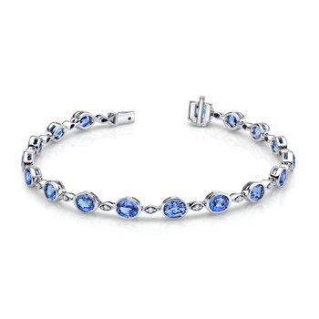 Oval Blue Topaz Bezel Set Bracelet