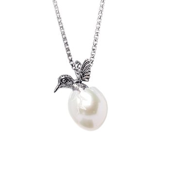 Sterling silver hatching hummingbird from pearl shell egg