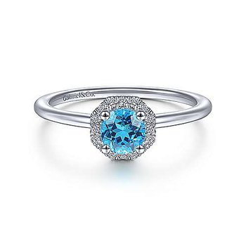 14KW .09CT DIA & .54CT BLUE TOPAZ FASHION RING