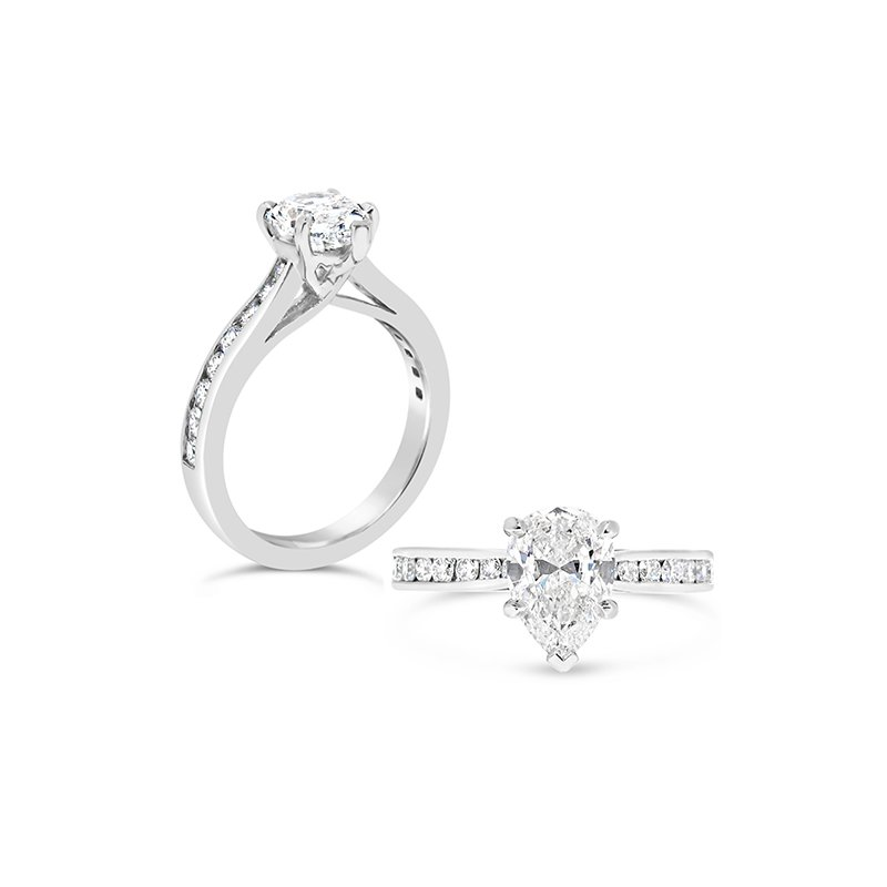 Aires Custom Bridal pear shape center with diamonds