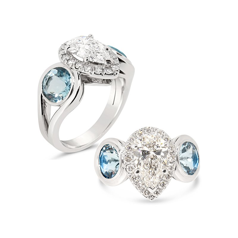 Aires Custom Bridal pear shaped center with aquamarines ring
