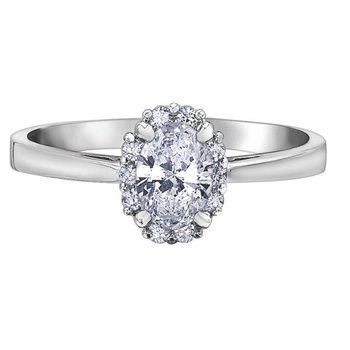 Halo Engagement Ring With Oval Cut Diamond.