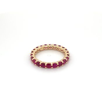 Ruby eternity band set in yellow gold