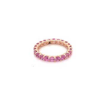 Pink sapphire eternity band in rose gold