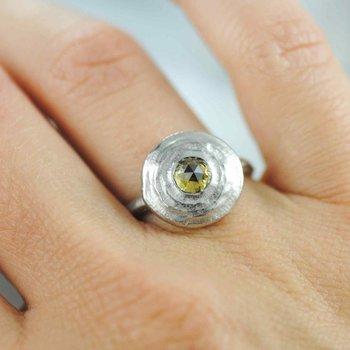 Circular Platinum Ring with a Yellow Diamond (0.62ct) Center