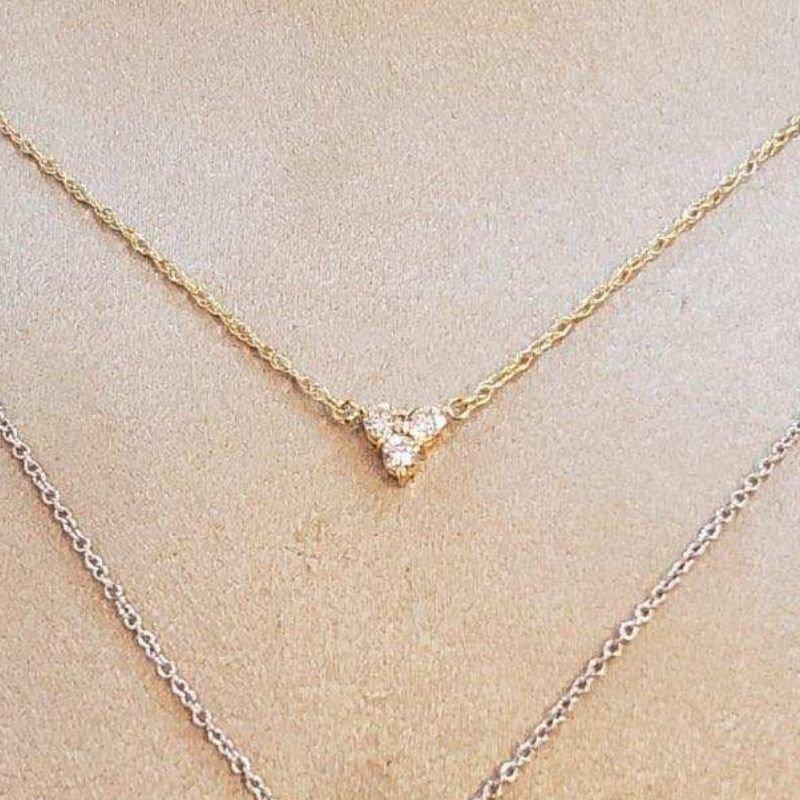 Grant Dorangrichia Gold triple diamond cluster necklace