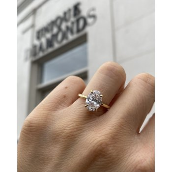 Oval Brilliant Four-Prong Solitaire