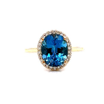 14 Karat Yellow Gold Oval Blue Topaz Fashion Ring with Diamond Halo