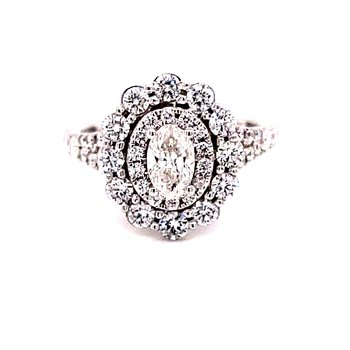 14 Karat White Gold Oval Cut Center Stone with Double Diamond Halo and Diamond Shank Engagement Ring with Matching Diamond Band