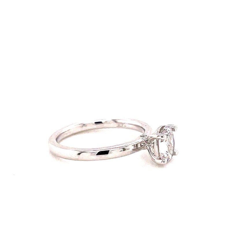 Corinth Collections  14 Karat White Gold 4 prong Oval Solitaire with Hidden Diamond Detail Engagement Ring