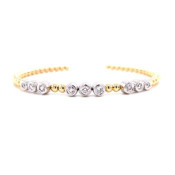 14 Karat Yellow and White Gold Triple Diamond Cuff with Bezel Set Diamonds