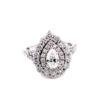 14 Karat White Gold Pear Cut Center Stone with Double Diamond Halo and Diamond Shank Engagement Ring with Matching Diamond Band
