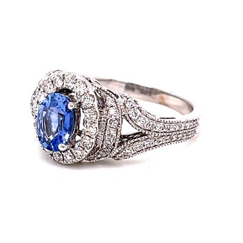 14 Karat White Gold Oval Cut Sapphire with Diamond Halo and Milgrain Accent Vintage Fashion Ring with Split Shank