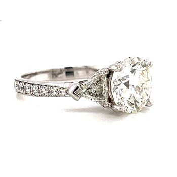 14 Karat White Gold Three Stone Round Brilliant Cut Center Accented with Trillions Engagement Ring