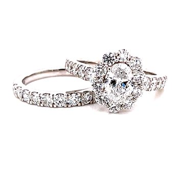 14 Karat White Gold Lab Grown Oval Cut Center Stone with Round Diamond Halo Engagement Ring with Matching Diamond Band