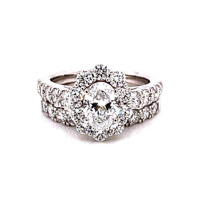 Corinth Collections  14 Karat White Gold Lab Grown Oval Cut Center Stone with Round Diamond Halo Engagement Ring with Matching Diamond Band