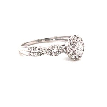 14 Karat White Gold Oval Center with Diamond Halo and Infinity Shank Engagement Ring