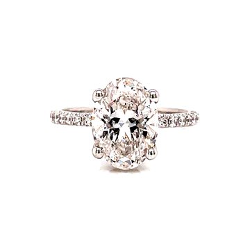 14 Karat White Gold Oval Solitaire with Hidden Diamond Halo and Diamond Shank Engagement Ring