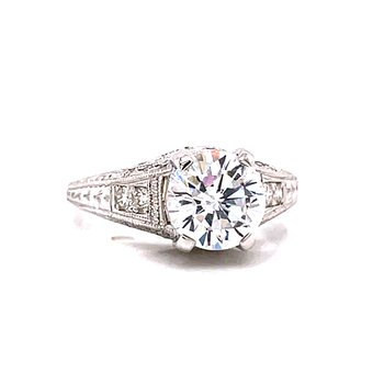 14 Karat White Gold Round Vintage Style Solitaire Engagement Ring with Tapered Diamond Shank and Milgrain Details