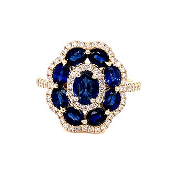14 Karat Yellow Oval Cut Sapphires with Round Diamond Flower Halo Fashion Ring