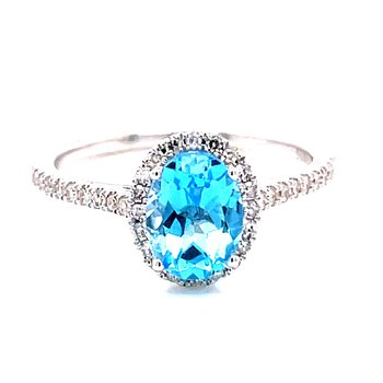 14 Karat White Gold Oval Cut Blue Topaz with Diamond Halo and Shank Fashion Ring