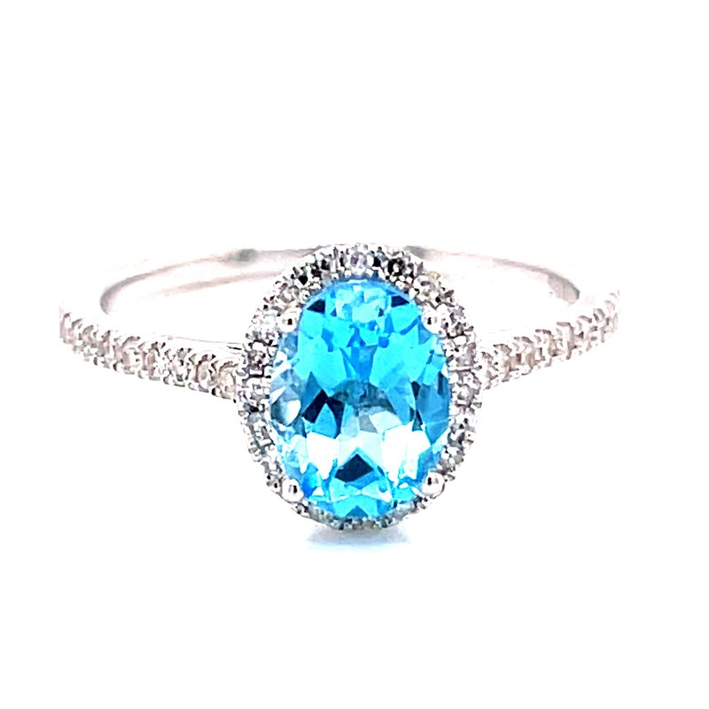 Corinth Collections  14 Karat White Gold Oval Cut Blue Topaz with Diamond Halo and Shank Fashion Ring