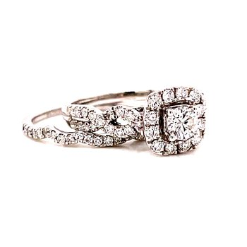 14 Karat White Gold Round Center with Cushion Diamond Halo and Infinity Diamond Shank Engagement Ring with Matching Band