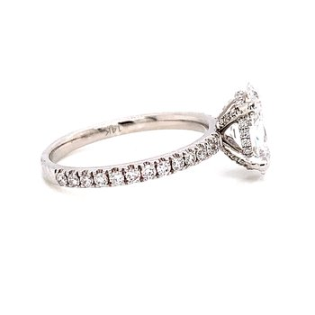 14 Karat White Gold Oval Solitaire with Hidden Halo and Diamond Shank Engagement Ring