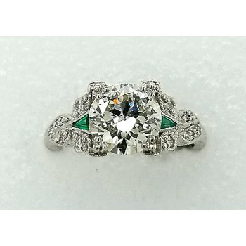 Platinum Engagement Ring with Emerald Accents