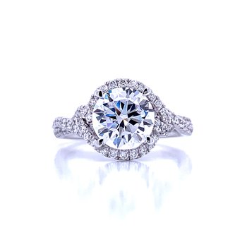 Contemporary Round Diamond Halo Engagement Ring With Twisted Shank