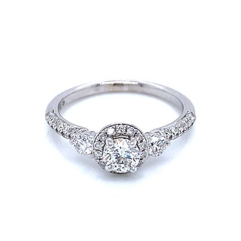 Three Stone with Halo center Engagement Ring