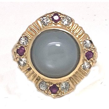 Lady's vintage grey stone, red stones, clear stones and yellow gold ring